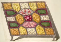 A silver tray with different compartments filled with flowers